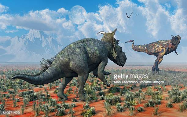 A Pachyrhinosaurus confronting a Carnotaurus.