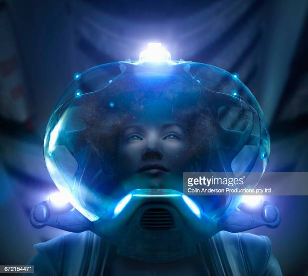 Pacific Islander woman wearing glowing helmet and space suit