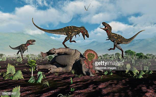 A pack of carnivorous Nanotyrannus dinosaurs attacking a lone Triceratops during the Cretaceous Period.