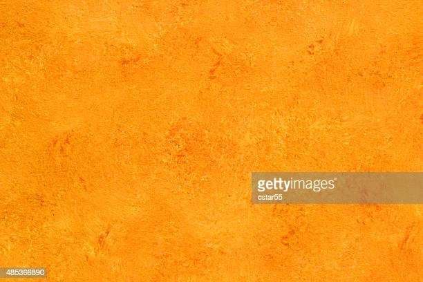 Painted orange gold watercolor background with texture