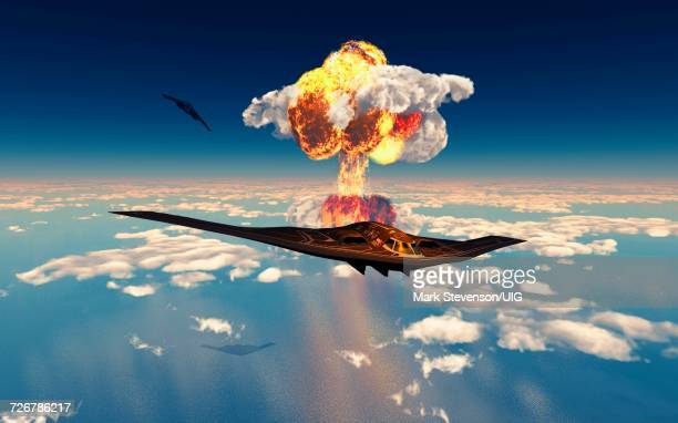 pair of b-2 spirit stealth bombers flying away from atomic bomb explosion - us air force stock illustrations, clip art, cartoons, & icons
