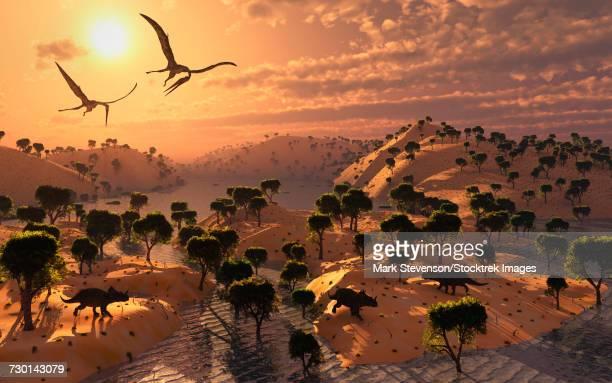 A pair of Quetzalcoatlus pterosaurs flying over a Cretaceous landscape.