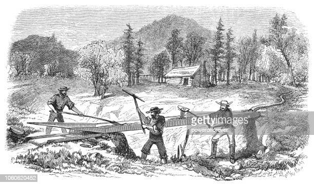panning for gold in california, usa (19th century) - california gold rush stock illustrations
