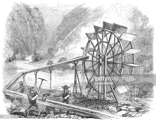 panning for gold using a flutter-wheel at the tuolumne river in california, usa (19th century) - sluice stock illustrations