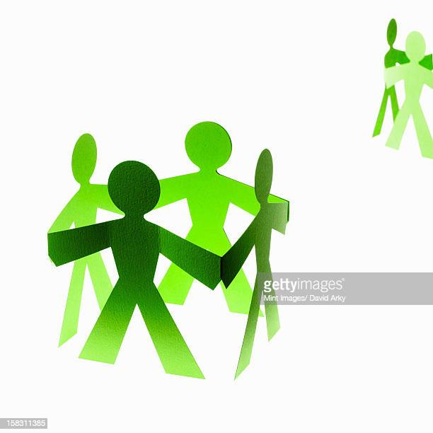 papercuts, paper cut out figures representing people with joined hands. - sports team stock illustrations, clip art, cartoons, & icons