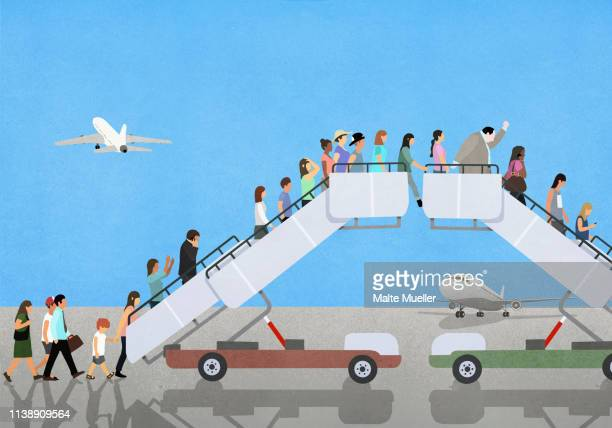 Passengers climbing and descending airport boarding stairs