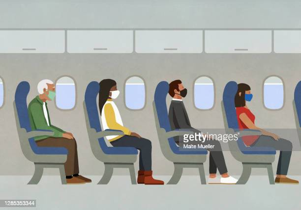 passengers in face masks riding in airplane - safety stock illustrations