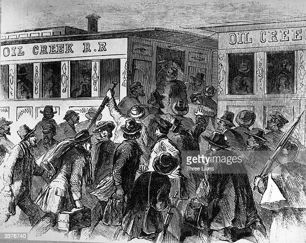 Passengers rush for carriages on the Oil Creek Railroad, Titusville, Philadelphia, desperate to get to the centre of the oil region.