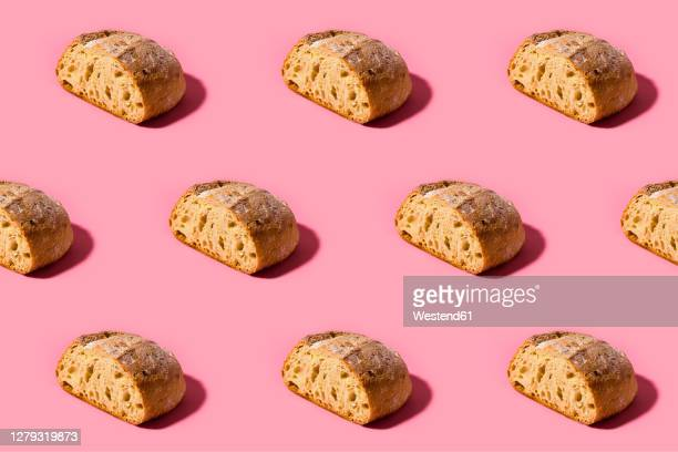 pattern of fresh loaves of bread against pink background - pattern stock illustrations