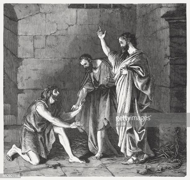paul and silas in prison (acts 16, 31), published 1886 - paul the apostle stock illustrations