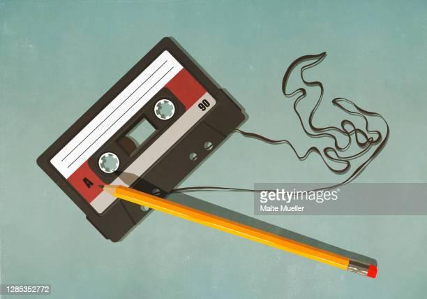 pencil unwinding cassette tape on green background - ideas stock illustrations