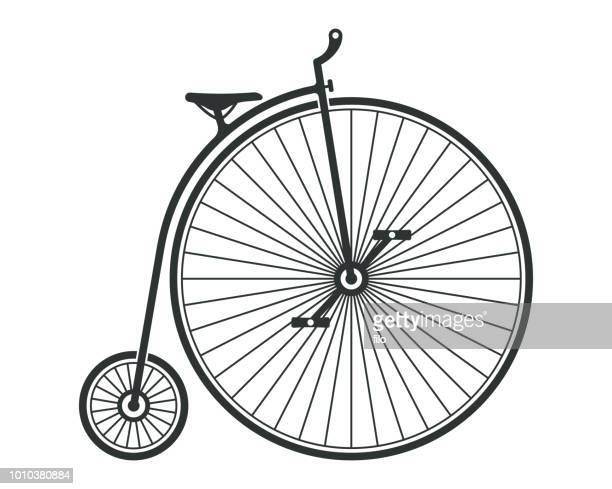 penny farthing bicycle - tall high stock illustrations