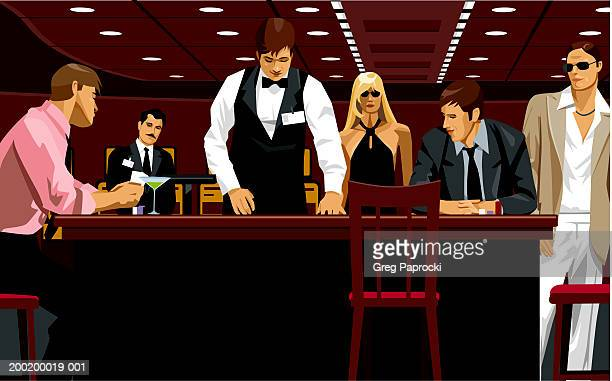 People in casino watching card dealer at gaming table