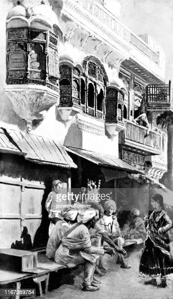 people on a street in lahore, pakistan - british raj era 19th century - punjab pakistan stock illustrations