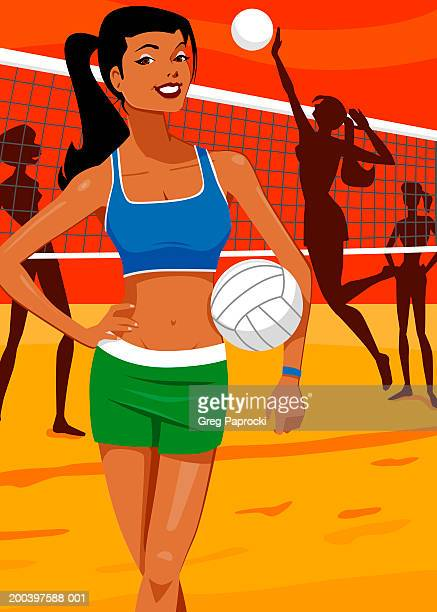 People playing beach volleyball (focus on young woman in foreground)