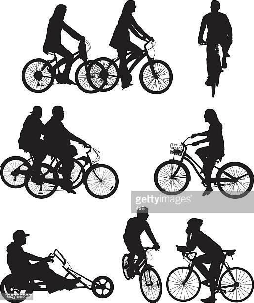 People riding bicycle bikes
