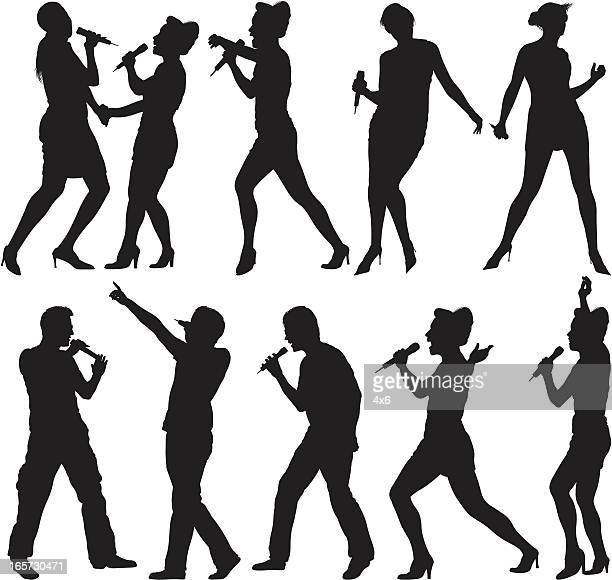 people singing into microphones - karaoke stock illustrations