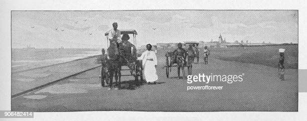 People traveling on a road in Bombay, India - British Era