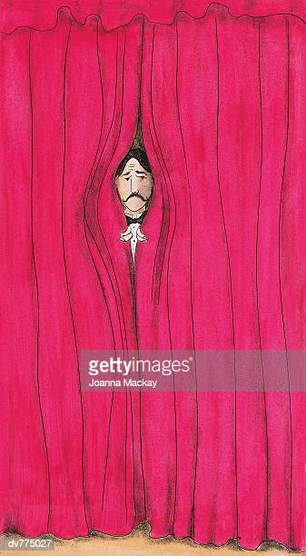 Performer Looking Out From Behind a Stage Curtain