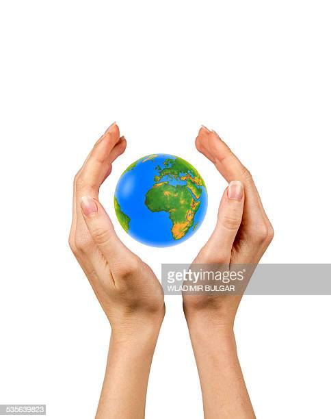 person holding the globe in their hands - protection stock illustrations