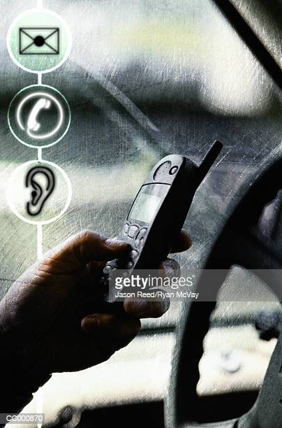 Person Using Cellular Phone in Car