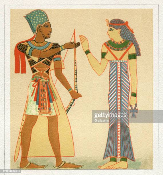 pharaoh and egyptian queen in traditional clothing - pharaoh stock illustrations