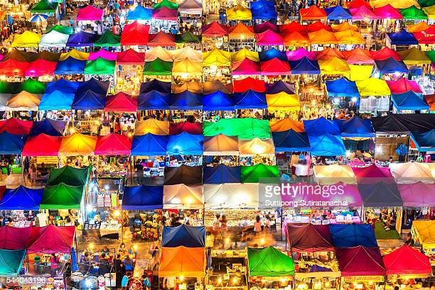 photo of night market high view from building colorful tent retail shop and lighting - consumerism stock illustrations