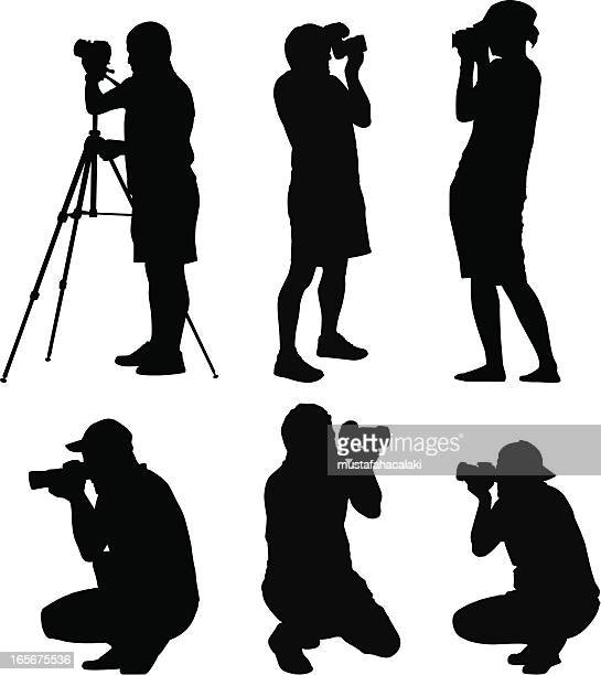 photographer silhouettes - camera tripod stock illustrations, clip art, cartoons, & icons
