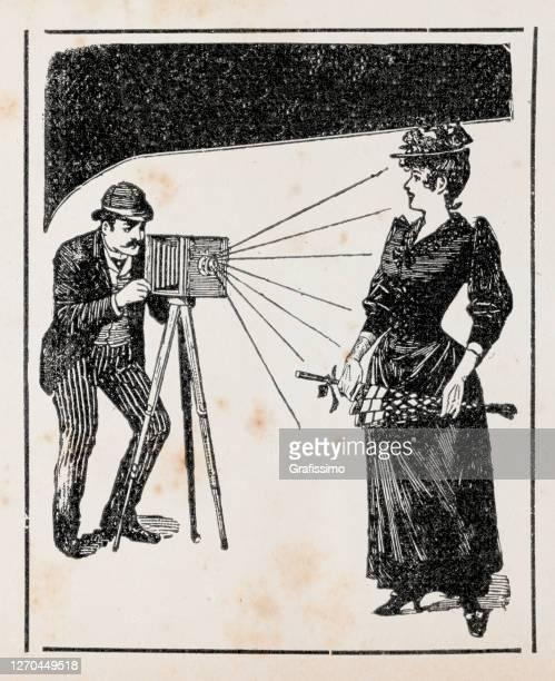 photographer taking photo of woman 1899 illustration - 1900 stock illustrations