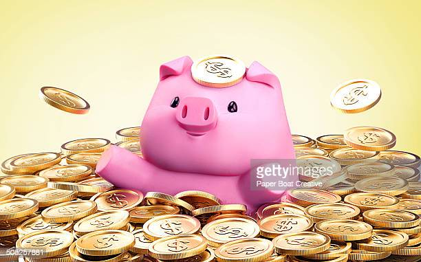Piggy Bank swimming in a stack full of gold coins
