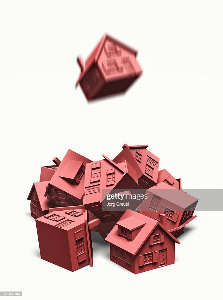 Pile of houses, one falling down from above : stock illustration