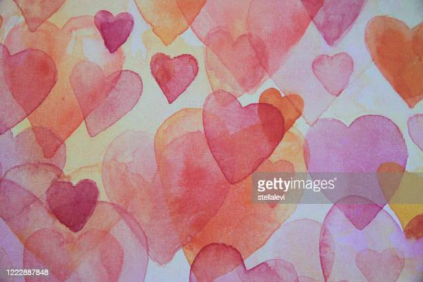 pink and red painted hearts in watercolor - stellalevi stock illustrations