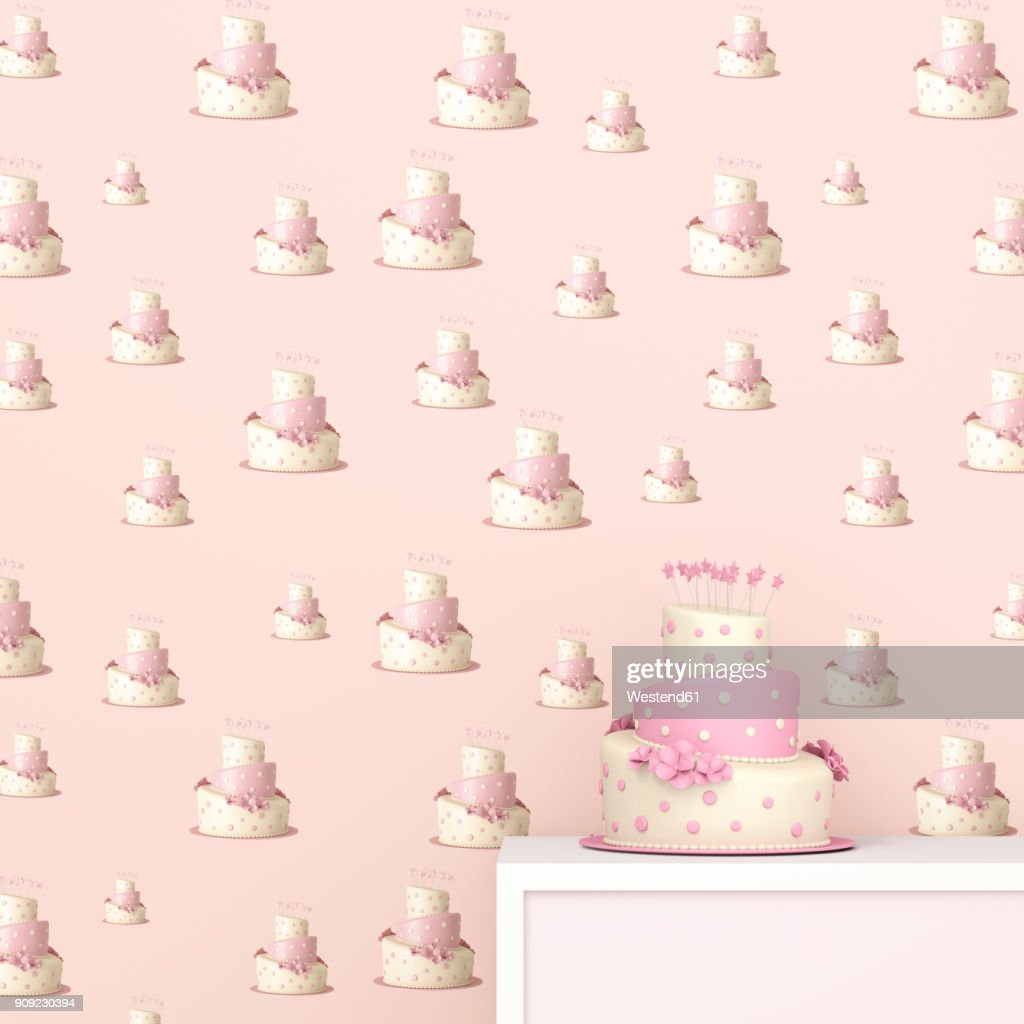 Pink And White Birthday Cake In Front Of Wallpaper With Fancy Cake