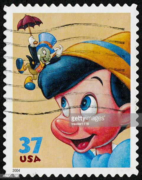 pinocchio stamp - disney stock illustrations