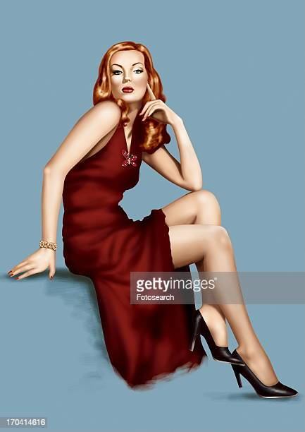 Pinup girl posing in red gown and black heels