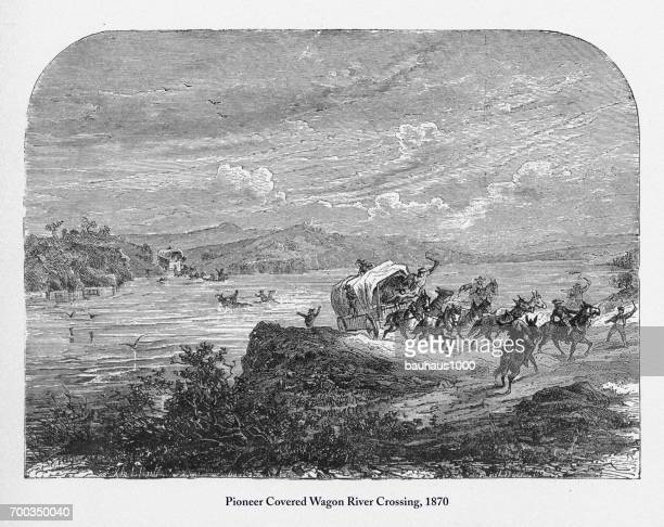 pioneer covered wagon river crossing, early american victorian engraving, 1870 - prairie stock illustrations, clip art, cartoons, & icons