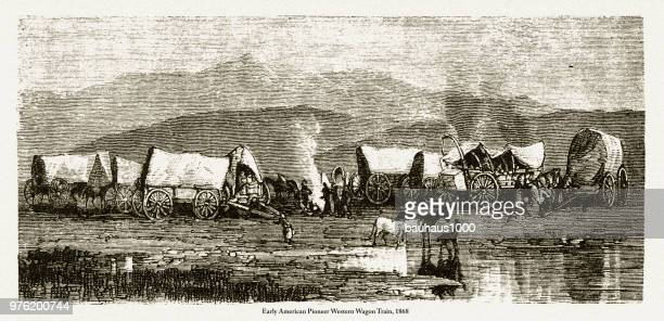 pioneer western wagon train, early american victorian engraving, 1868 - wild cattle stock illustrations, clip art, cartoons, & icons