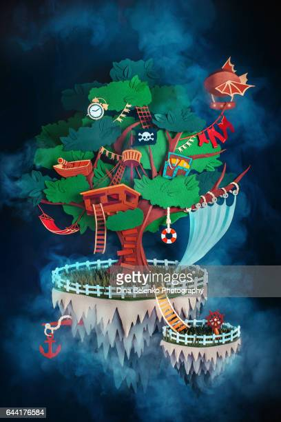 pirate treehouse on a floating island made from paper - fog stock illustrations