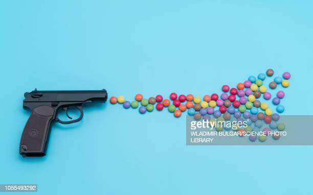pistol shooting sweets - handgun stock illustrations