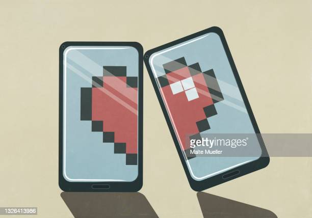 pixelated broken heart on smart phone screens - illustration stock illustrations
