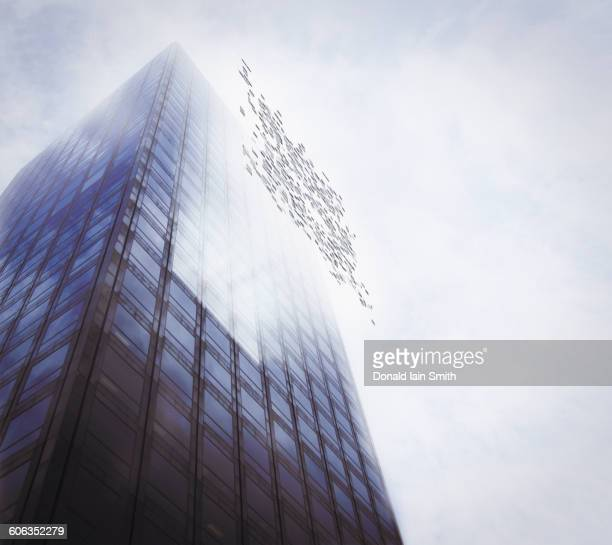 Pixelated highrise building and cloudy sky