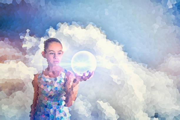 Pixelated Mixed Race girl holding glowing sphere