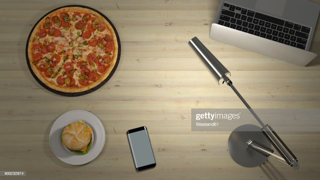 Pizza And Hamburger On A Desk With Lamp And Laptop