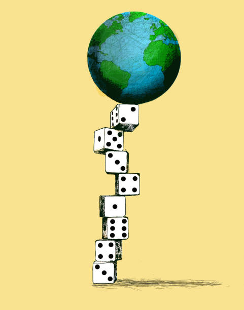 planet earth balanced on top of a column of dice