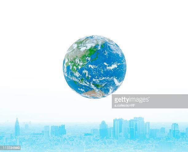 Planet earth floating over city, Digital Composite, Digital Enhancement