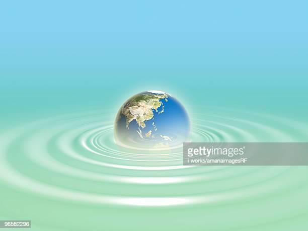 planet earth in water - 水の無駄遣い点のイラスト素材/クリップアート素材/マンガ素材/アイコン素材