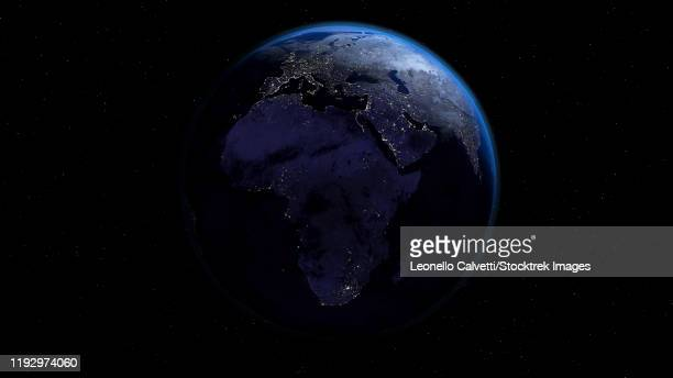 planet earth showing africa and europe in night time with city lights. - satellite view stock illustrations