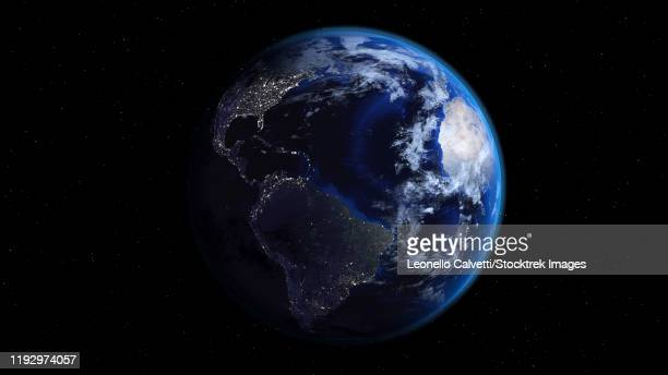 planet earth showing americas, half night and half day with city lights. - satellite view stock illustrations