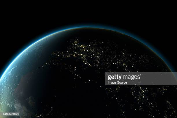 planet earth with lights of europe at night - lighting equipment stock illustrations