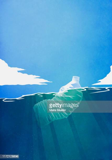 plastic bottle floating in ocean - image technique stock illustrations
